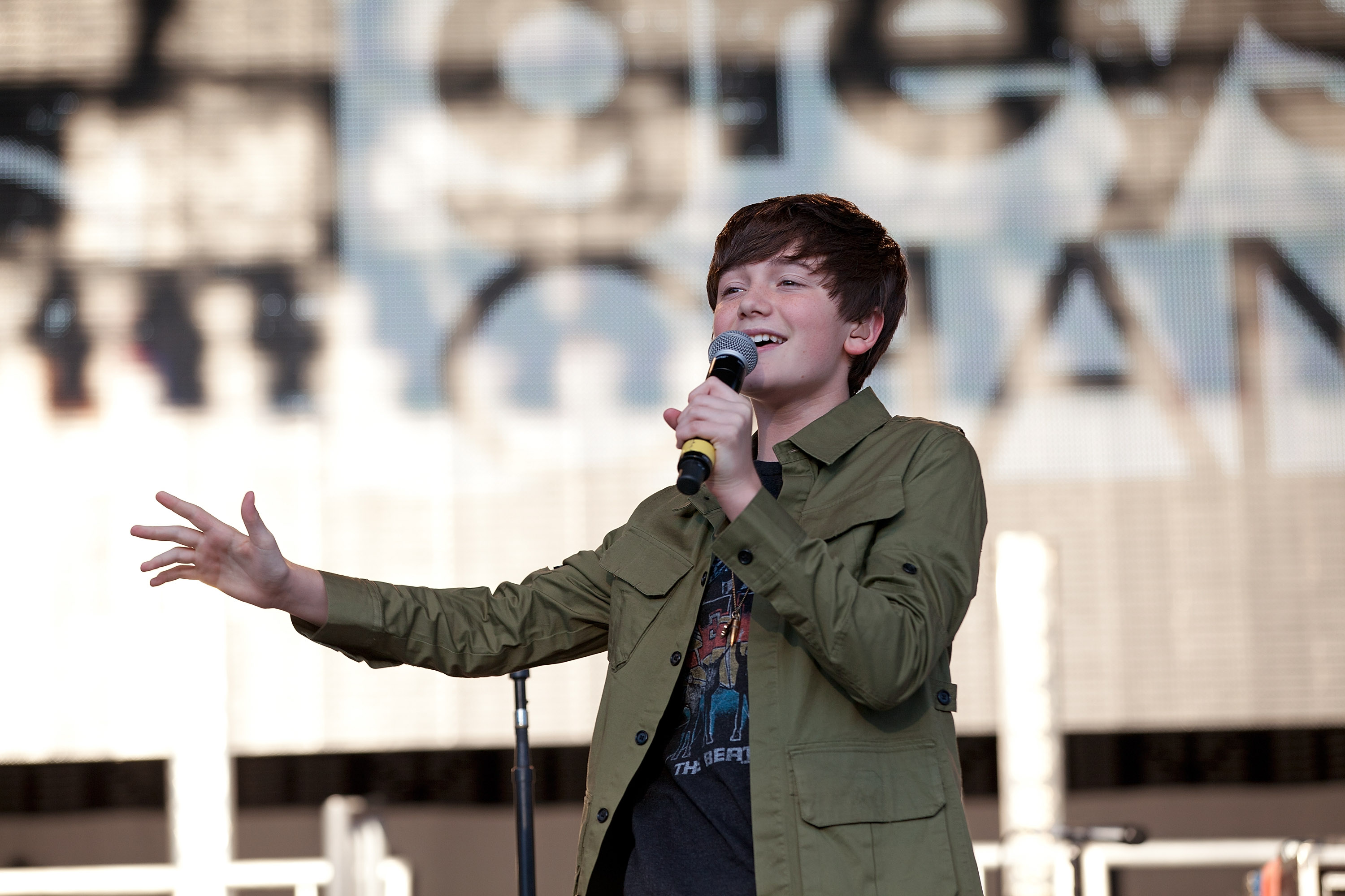 Miranda Cosgrove With Greyson Chance In Concert.