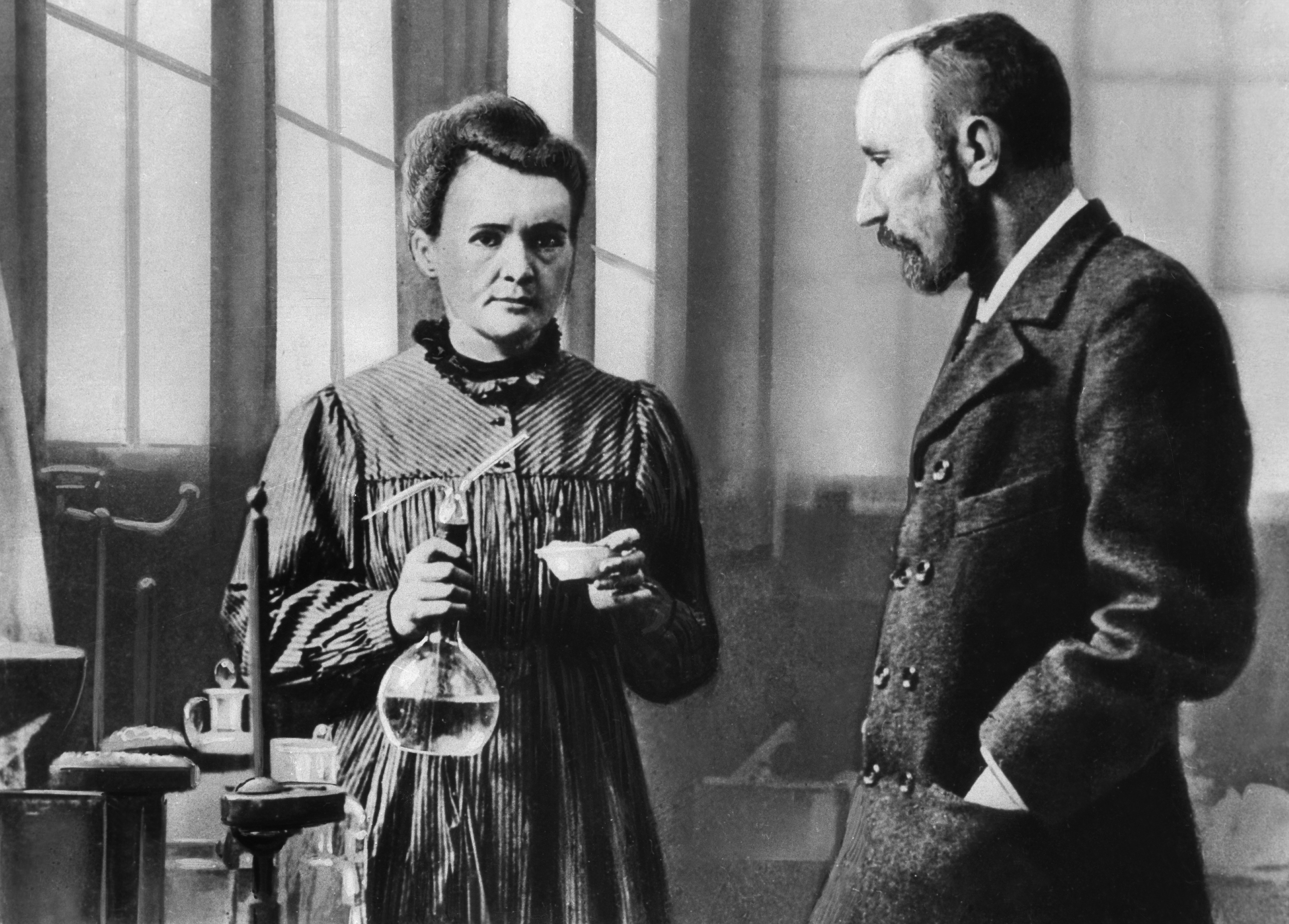 Marie Curie with husband Pierre at work in the laboratory