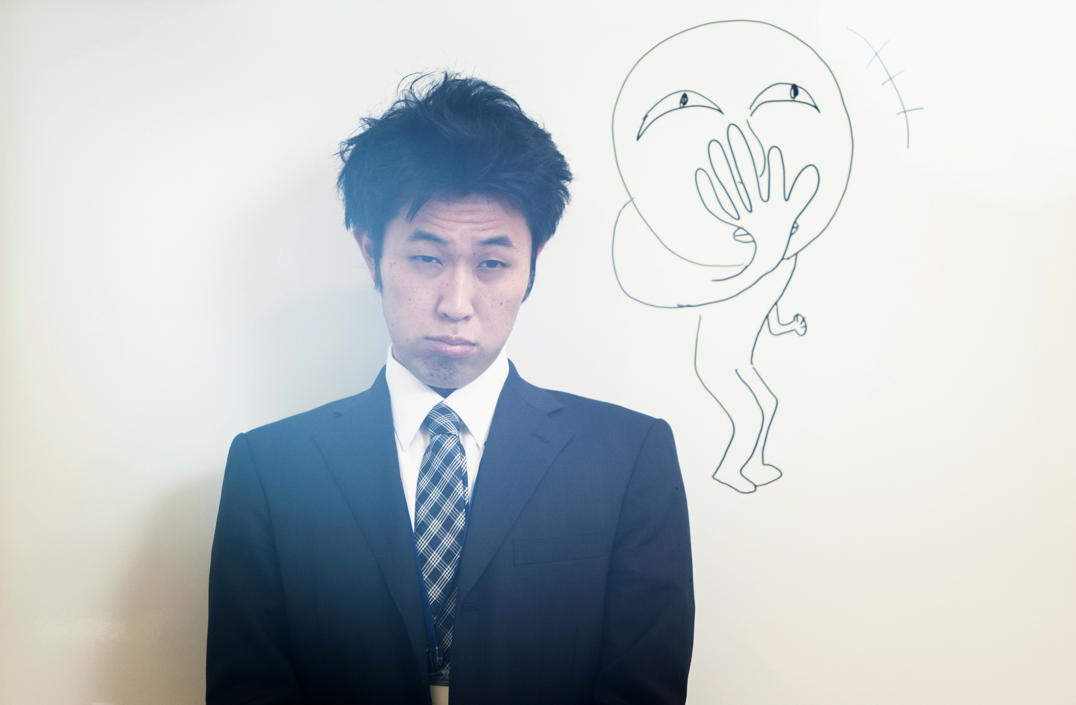 Japanese business man in front of a white board.