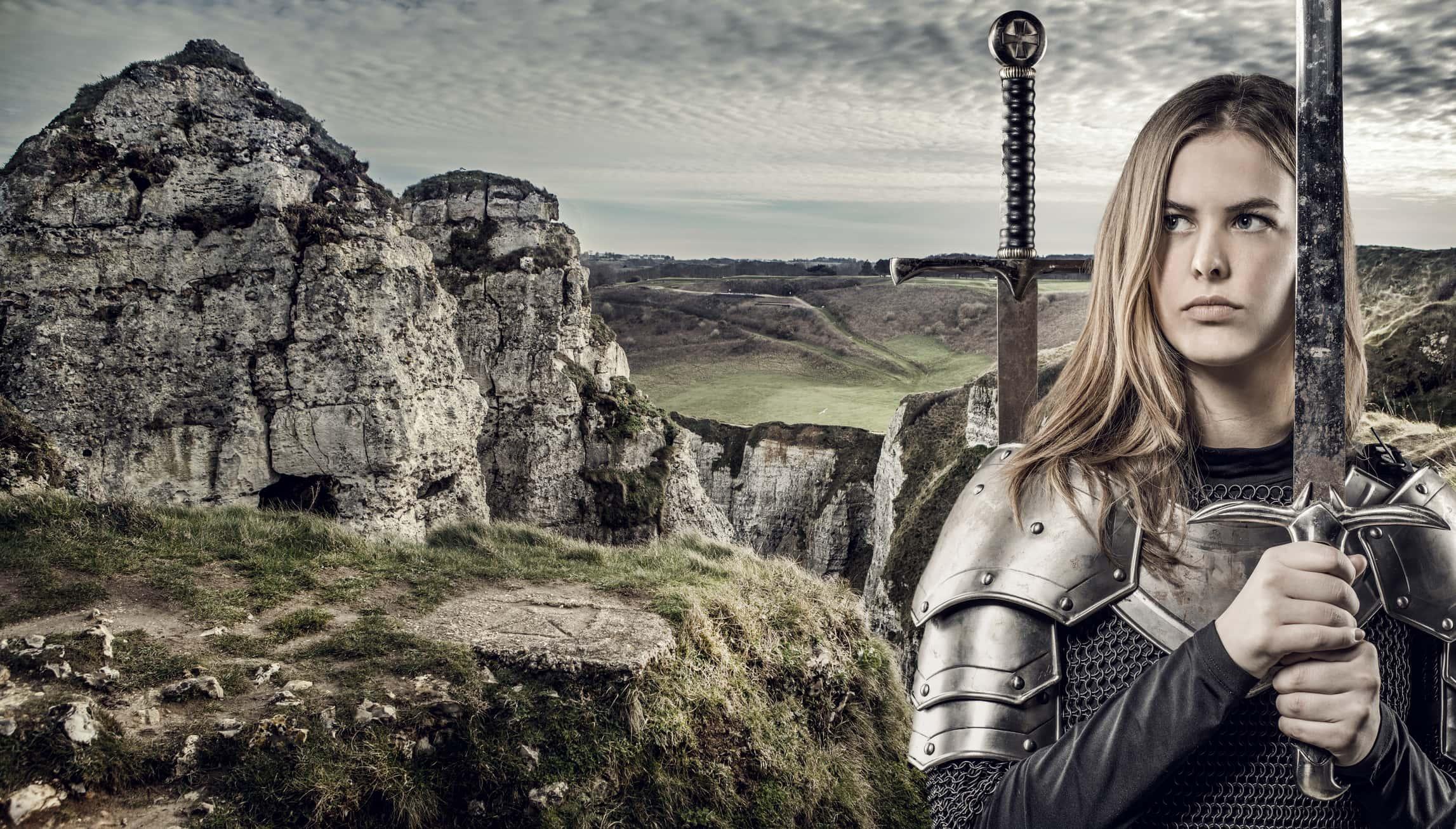 Sword wielding blond female Viking warrior.