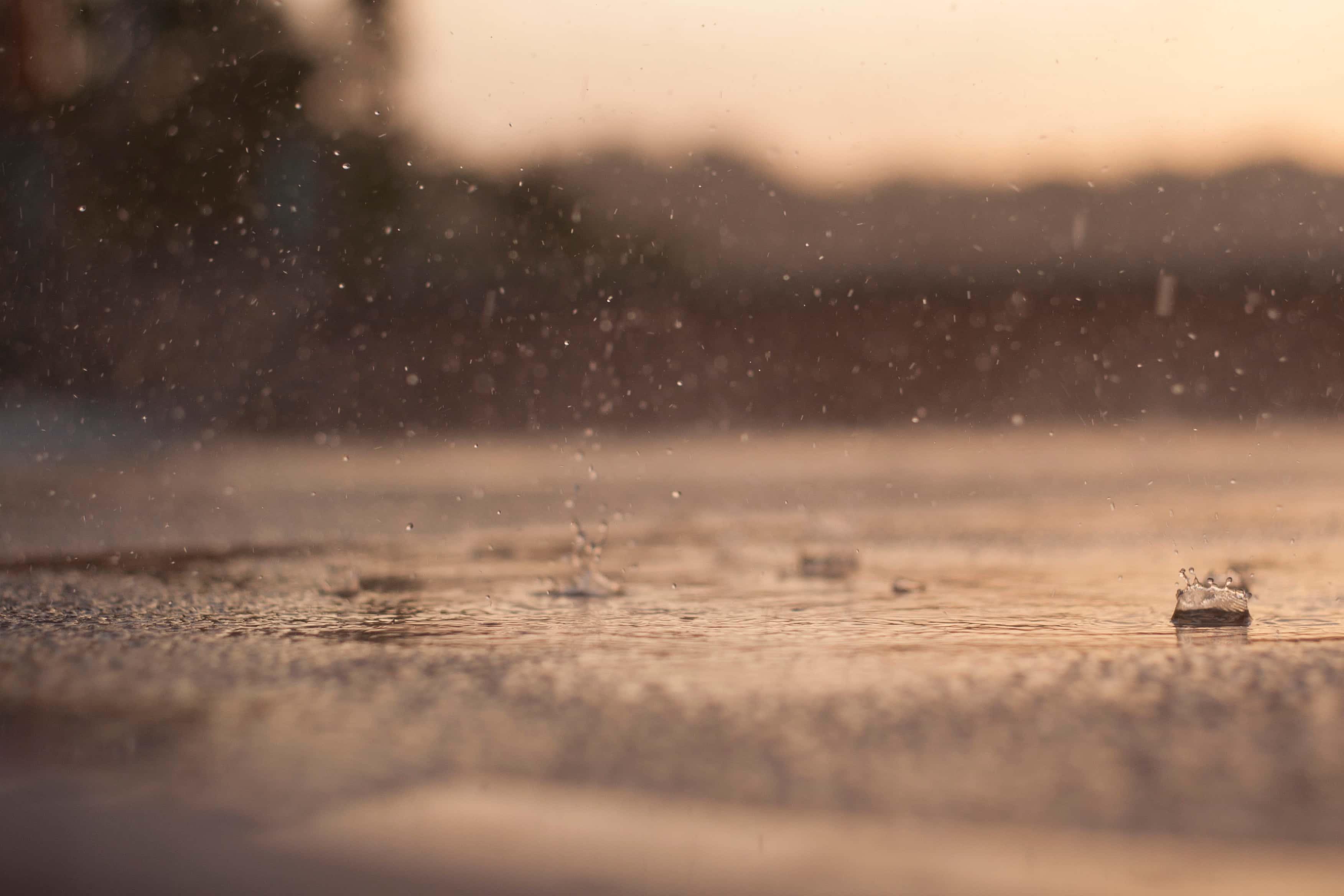 Rain Drops Falling On Street.