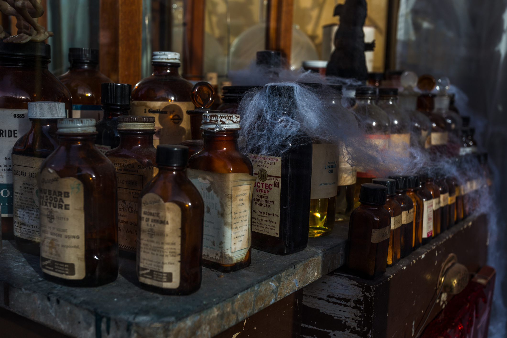 Display of old apothecary bottles