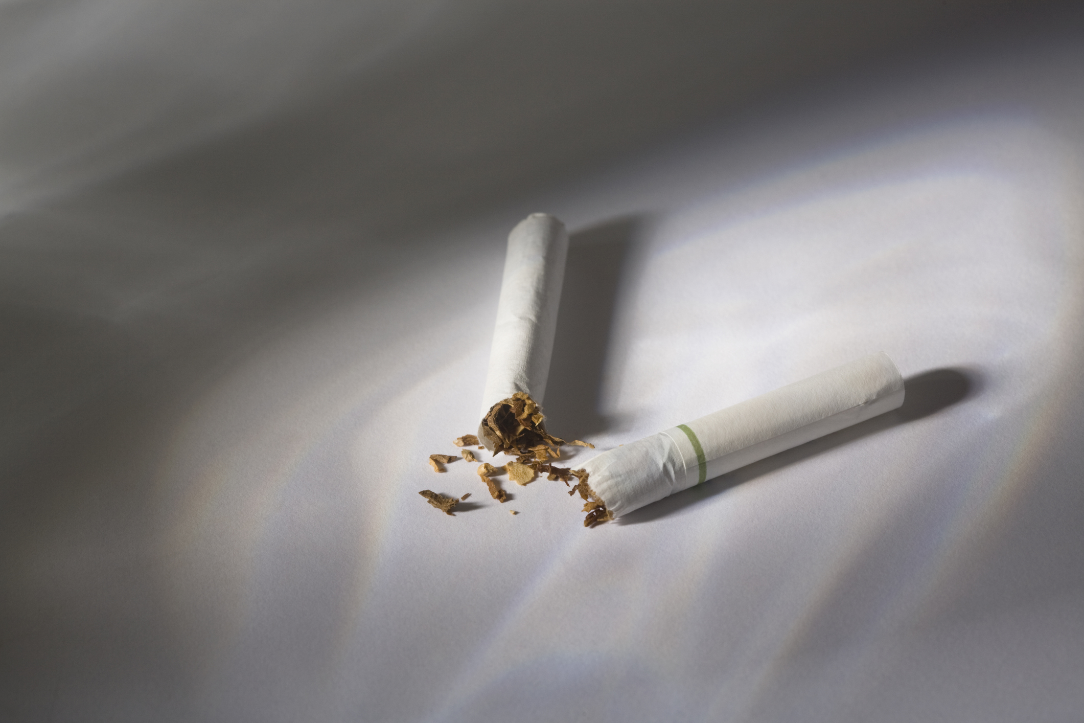 A cigarette broken in two.