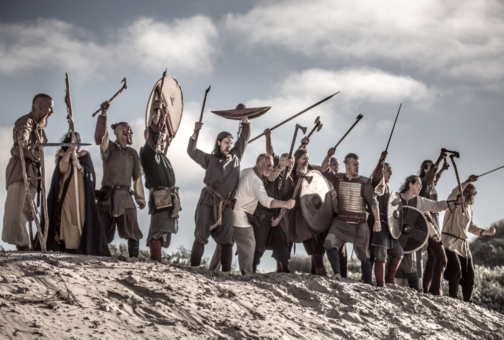 Vikings on a sandy battlefield dune.