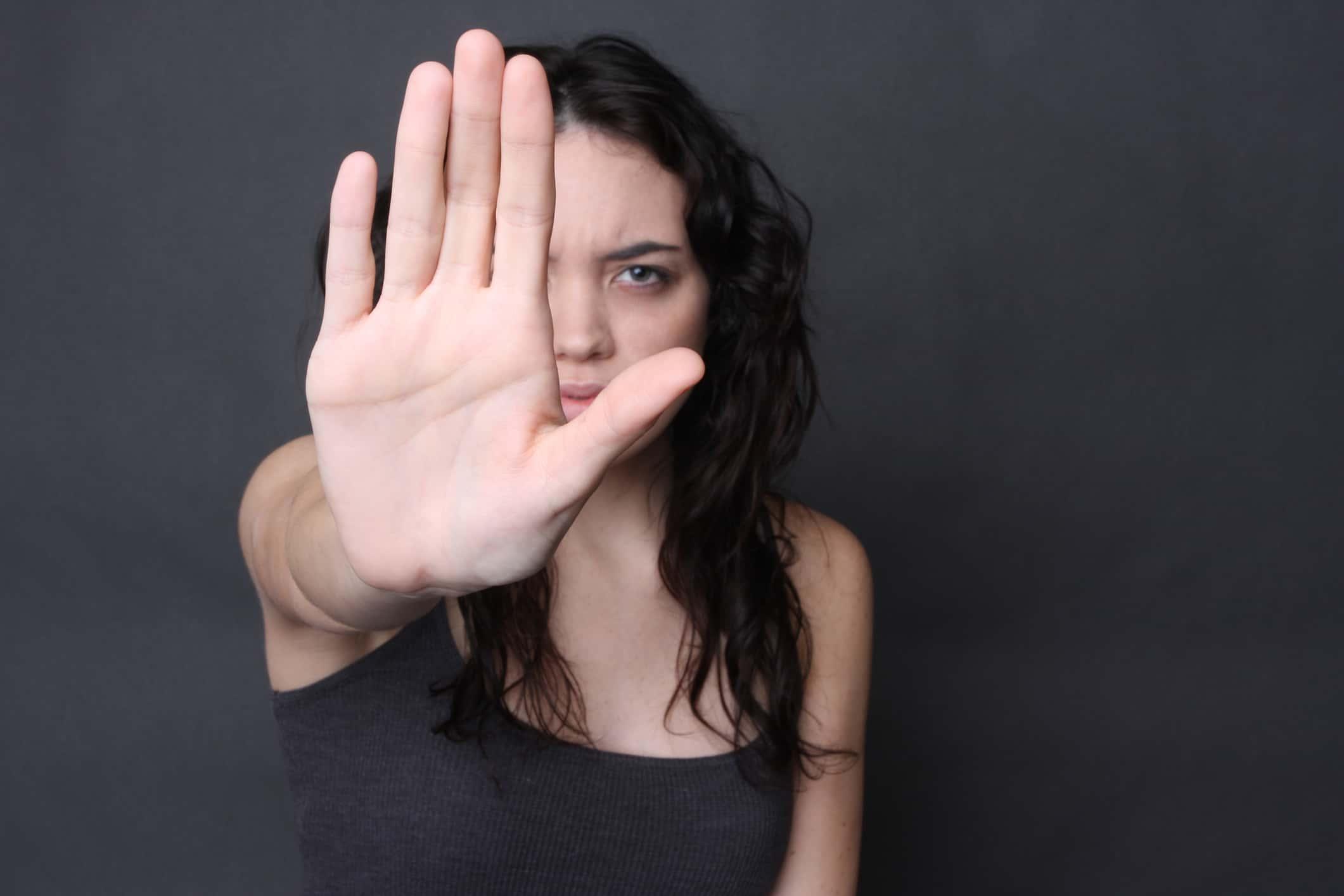 An angry looking girl in self defense gesture.