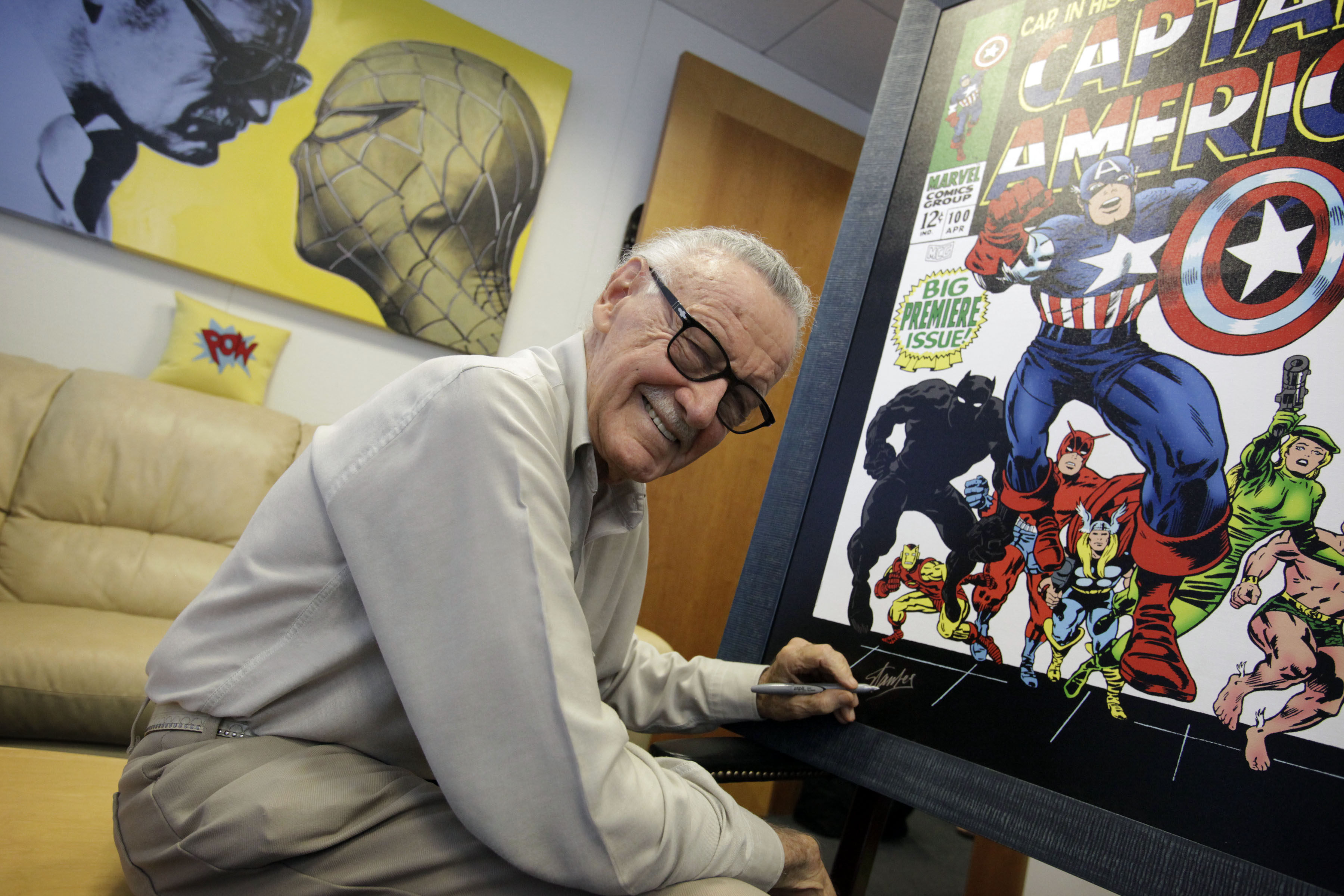Stan Lee signing poster for an upcoming exhibit in his Beverly Hills office.