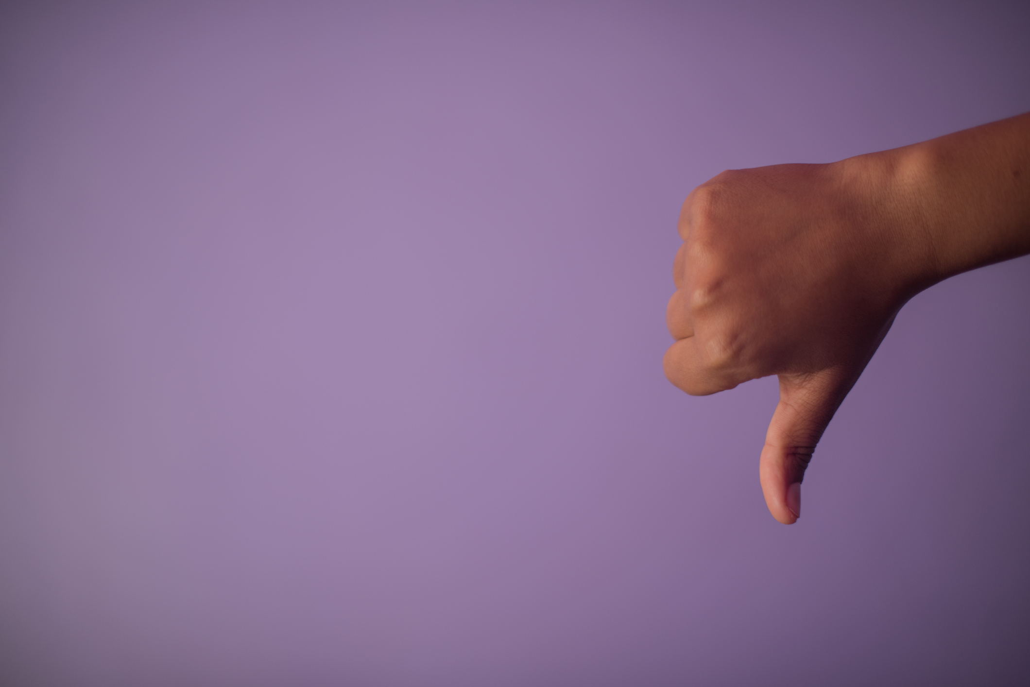 Close-Up Of Hand Giving Thumbs Down.