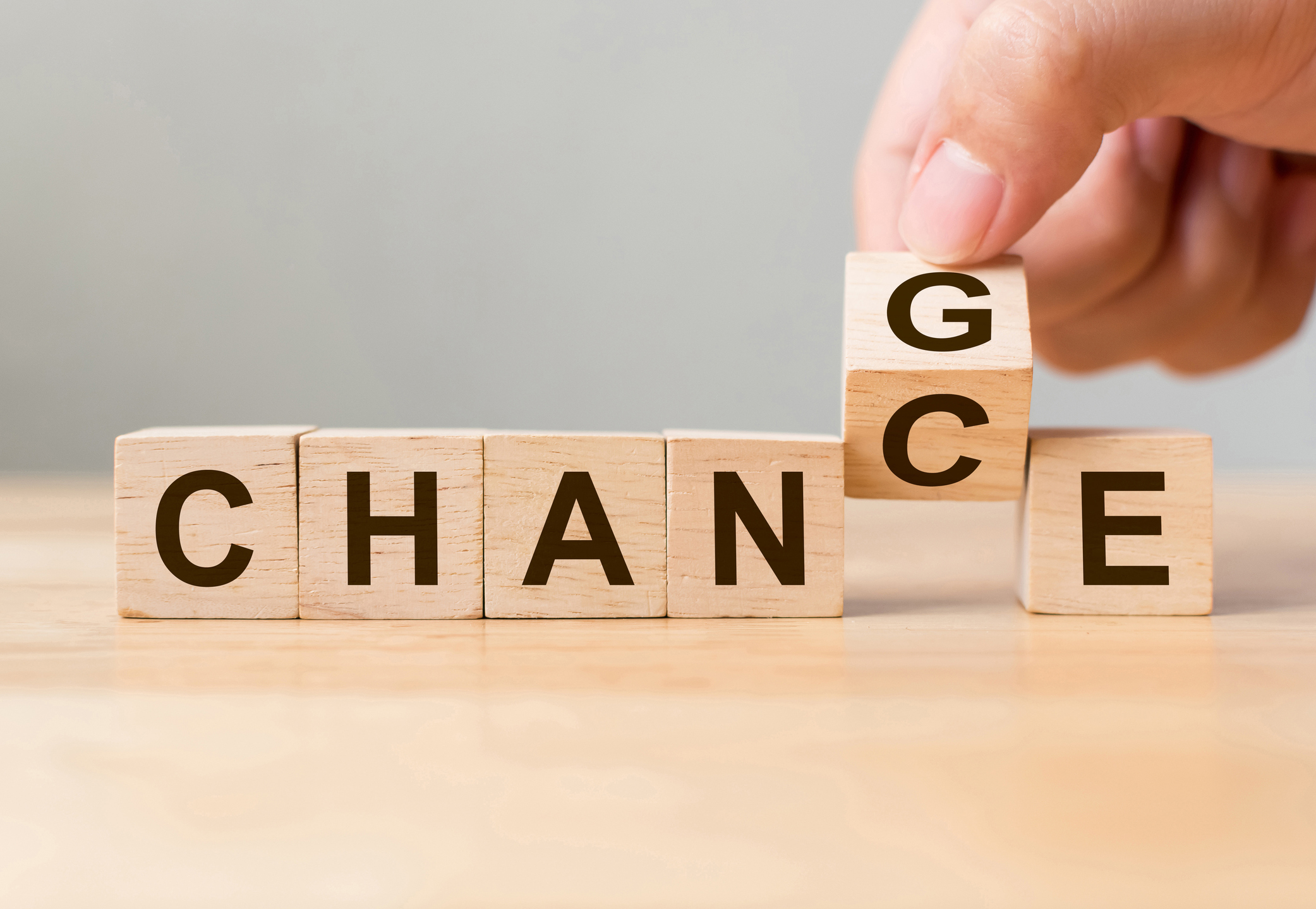 Wooden cube with word 'change' to 'chance'.