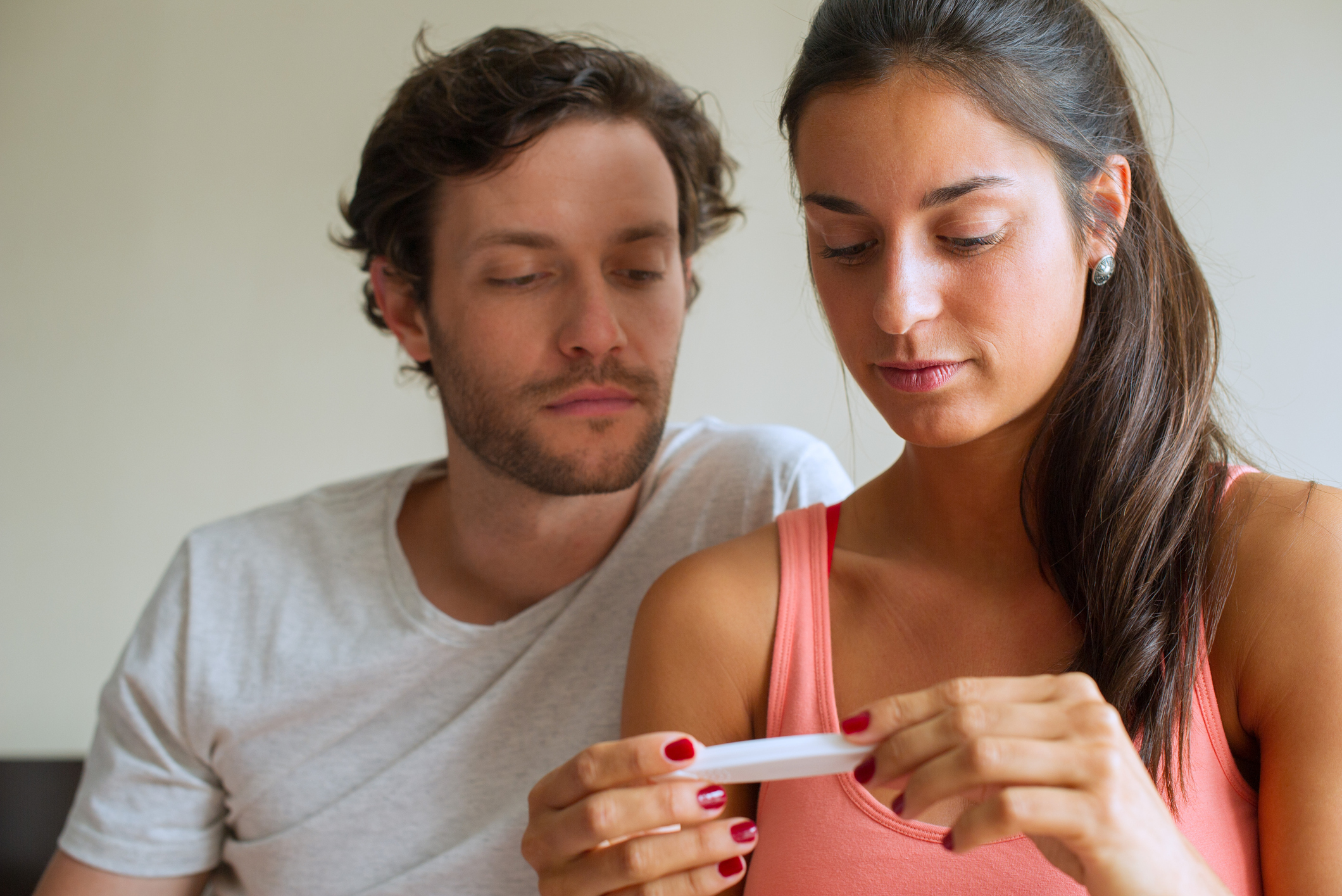 Couple looking at pregnancy test.