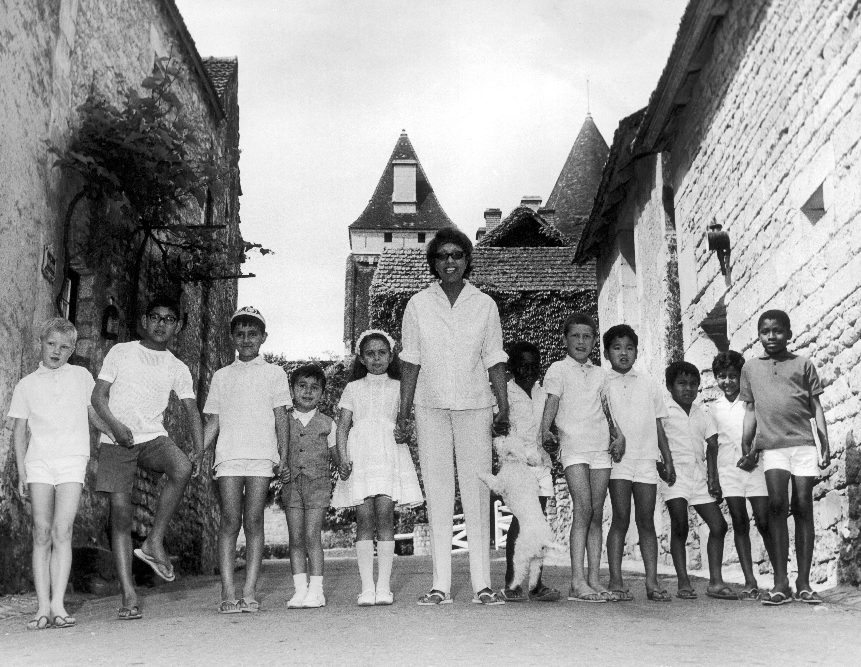 Josephine Baker Surrounded By Her Eleven Children In Dordogne, France.