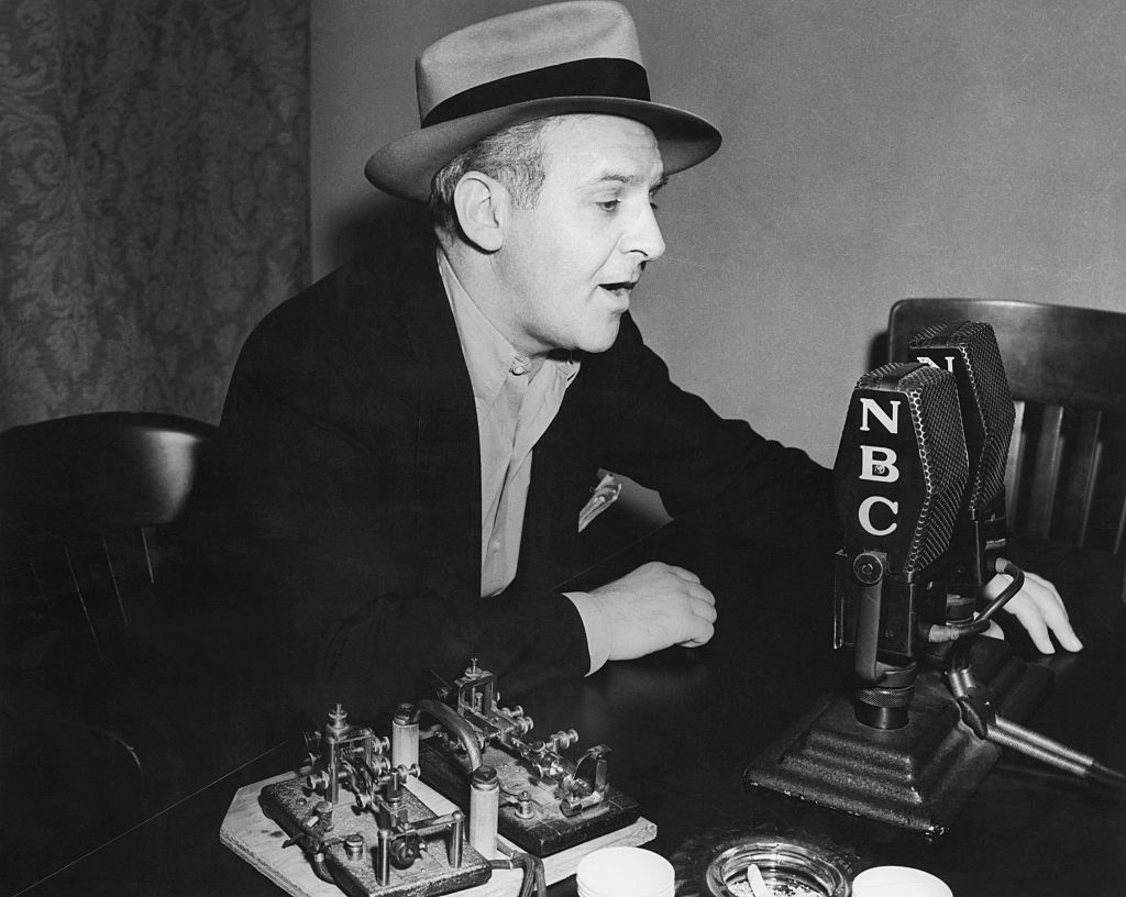 Walter Winchell Reporting.