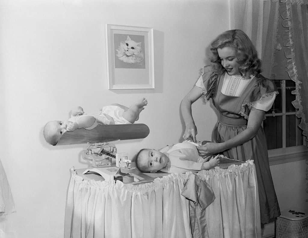 Marilyn Monroe Adjusting Baby's Diapers.