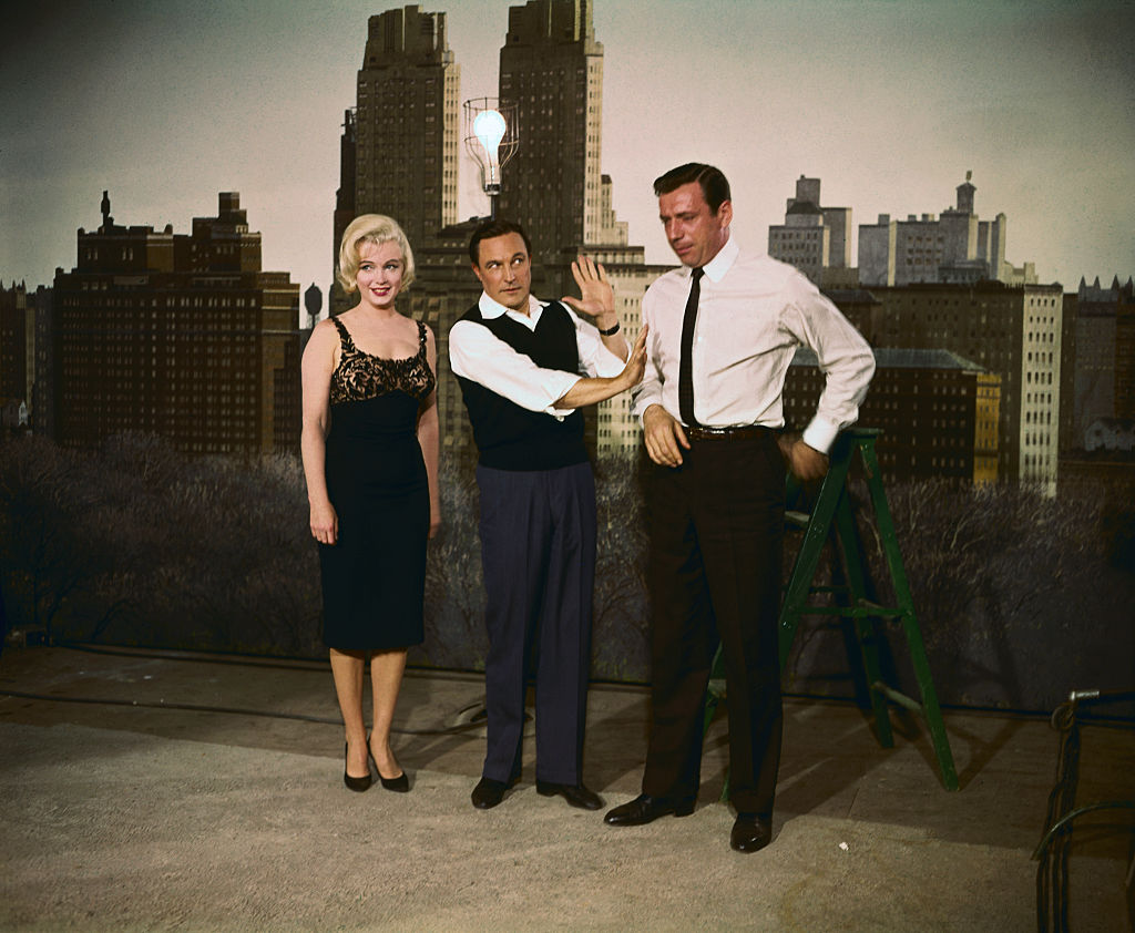 Marilyn Monroe, Gene Kelly, and Yves Montand.