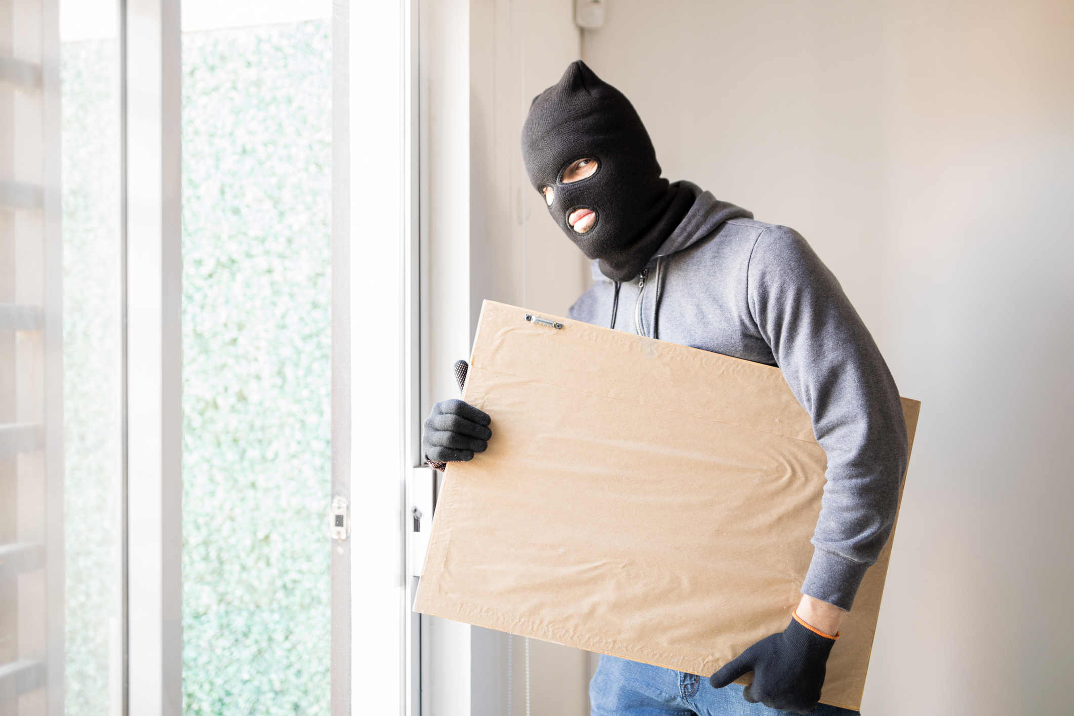 Male criminal stealing some art.