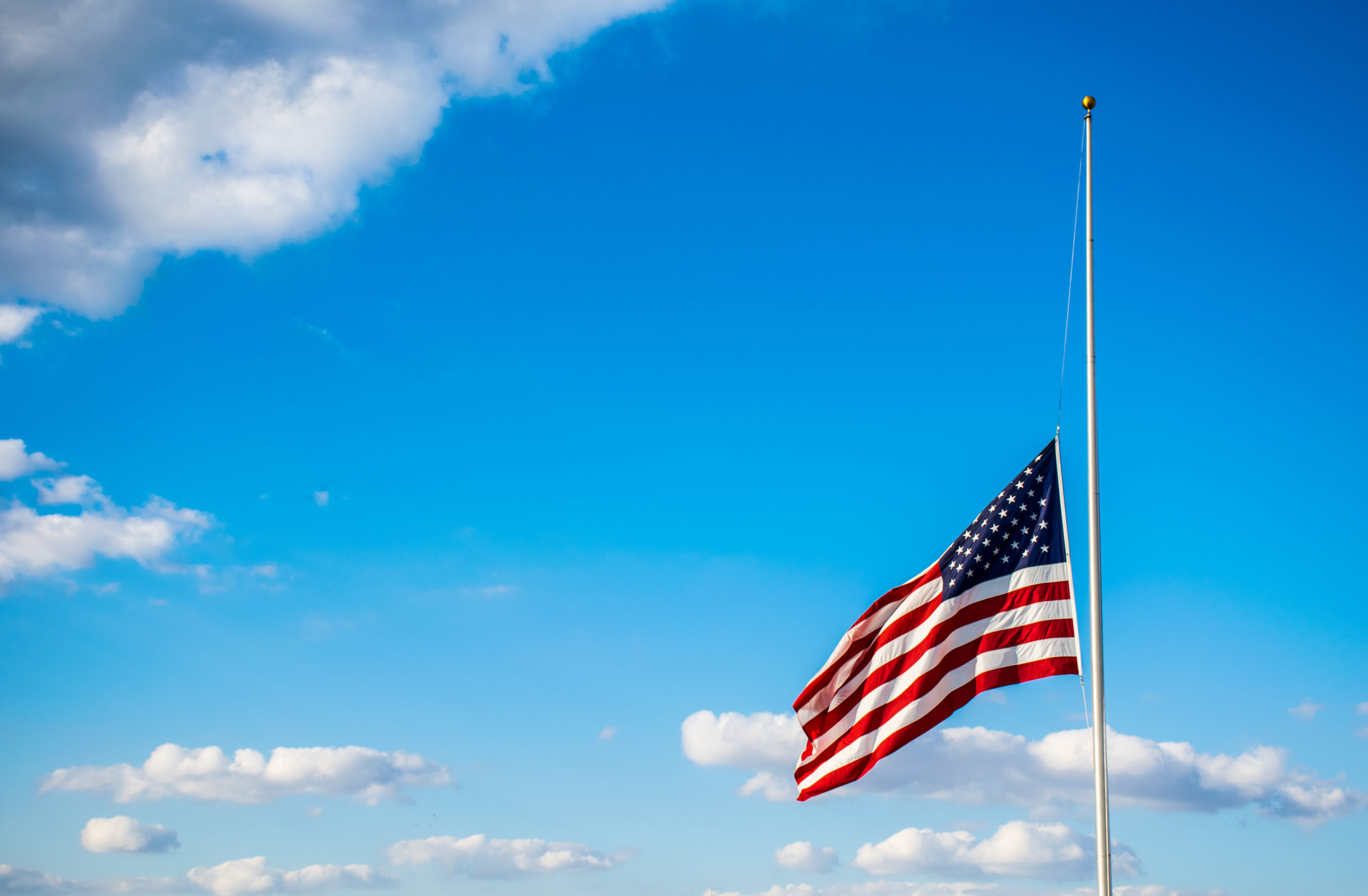 Why are flags at half mast editorial